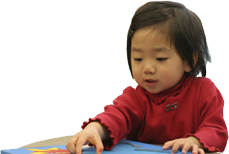 Young toddler solving a puzzle.
